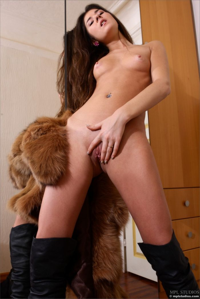 Pretty teen in furs