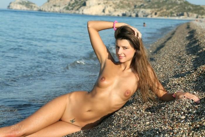 Sexy brunette on the beach