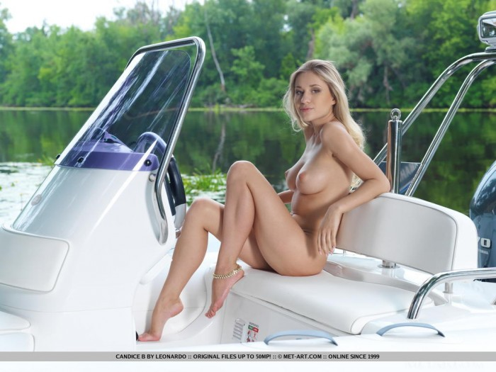 Sexy blonde Candice posing on the boat