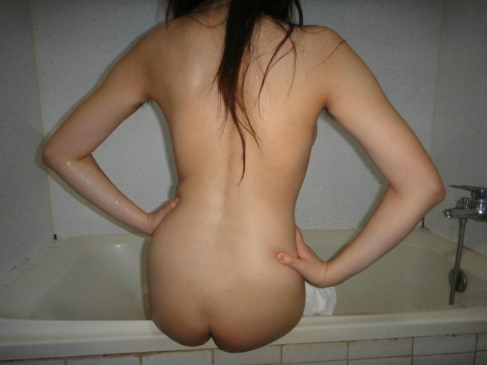 Sexy amateur Asian girl posing in the bathroom